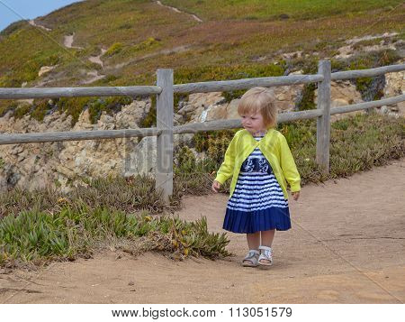 Little Girl Walks Along The Fence At Cape Cabo Da Roca