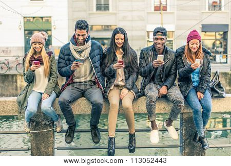 Multiracial Group Of People With Cellphones