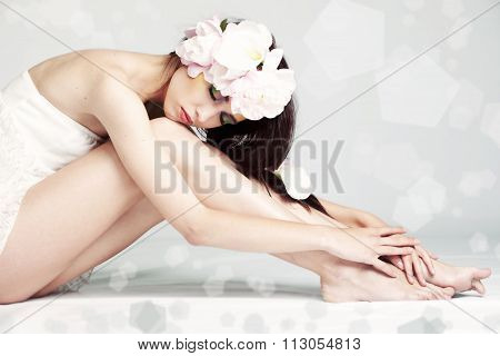 Girl portrait with flowers in hair