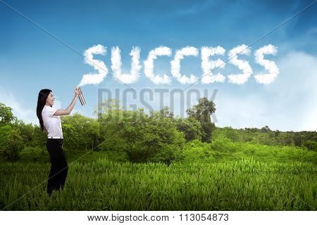 Business Person Spraying Bottle Of Aerosol Create Word Success