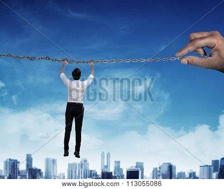 Asian Business Person Hanging On Chain