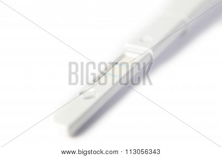 positive pregnancy test on white background, close-up