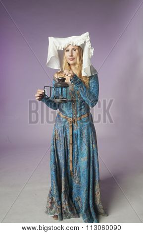 Medieval Girl With A Lamp