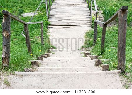 Wooden Bridge On A Country Road.