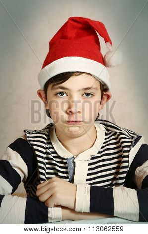 Close Up Portrait Of A Preteen Boy In Santa Hat