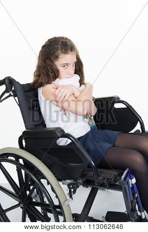 Invalid Young  Girl On Wheelchair Isolated On White