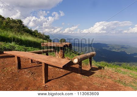Table And Chairs With Grass, Mountain And Cloudy Sky View Of Chiangmai Thailand