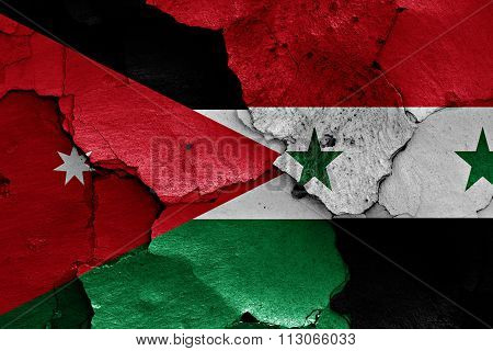 Flags Of Jordan And Syria Painted On Cracked Wall