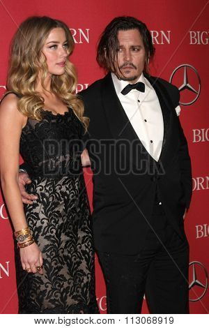 PALM SPRINGS - JAN 2:  Amber Heard, Johnny Depp at the 27th Palm Springs International Film Festival Gala at the Convention Center on January 2, 2016 in Palm Springs, CA