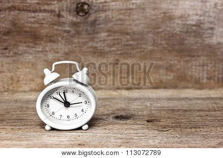 Alarm Clock On The Wooden Background