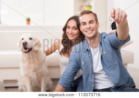 Cheerful loving couple is moving in new apartment