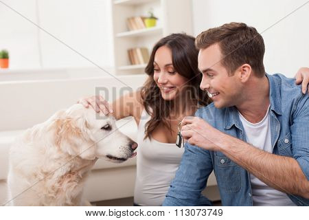 Attractive husband and wife with pretty animal