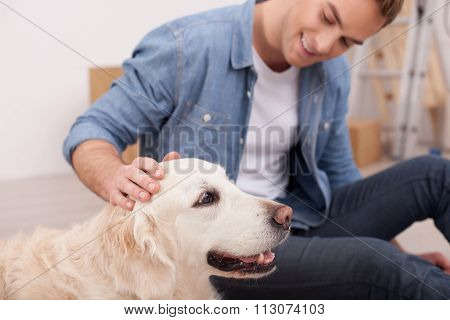 Attractive young guy is caressing his animal
