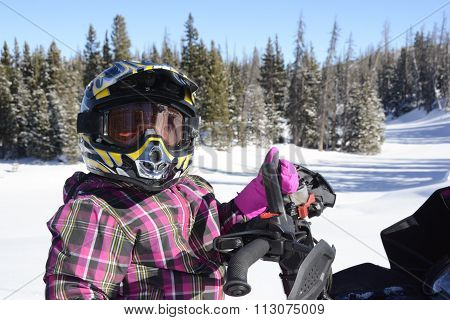 Child , Girl, Closeup Riding Snowmobile