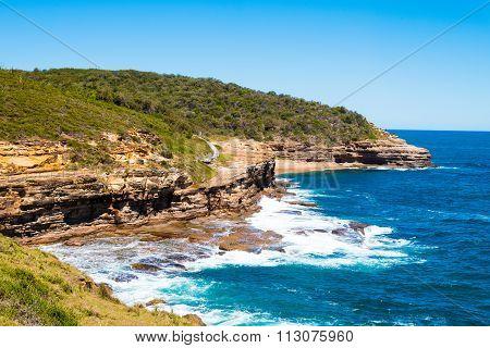 Australian Rock Formation With Ocean In Background, Sandstone Texture