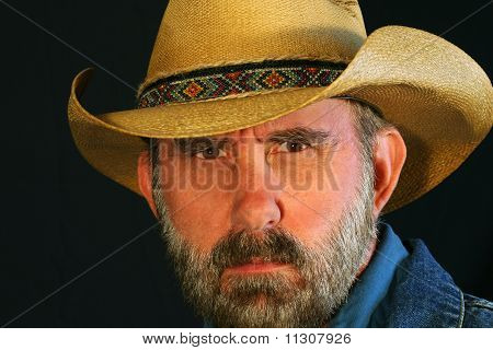 A Bearded Cowboy Squints