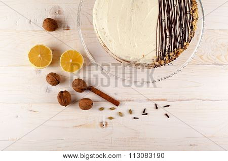Carrot cake with walnuts and white cream. Top view.