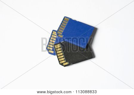 Three Sd Chips Isolated In White - Extreme Close Up