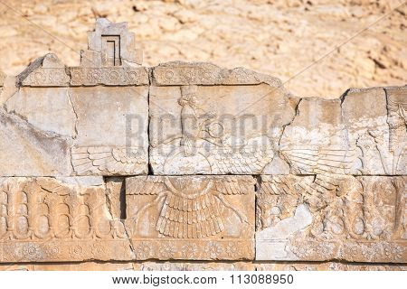 Faravahar - relief of winged sun symbol of Zoroastrianism in ruined Persepolis city