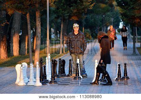 Couple playing street chess in Sumgait, Azerbaijan