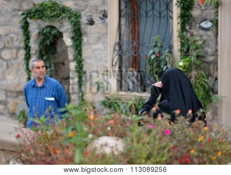 Woman in black Islamic dress in Baku's Old City, Azerbaijan