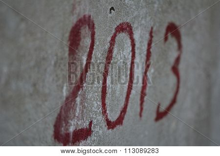 2013 graffiti in red on wall
