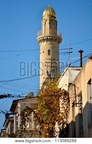 Minaret and messy telecoms cables in Baku, capital of Azerbaijan