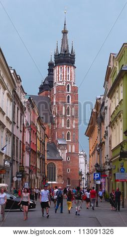 A Street With A Tower Of The St. Mary's Church In Krakow, Poland