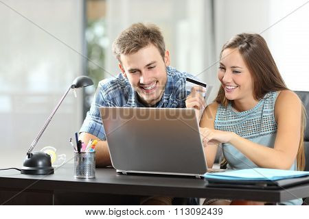 Couple Buying Online Together At Home