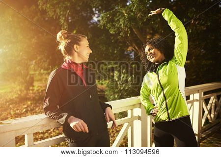 Two Sportswomen Stretching