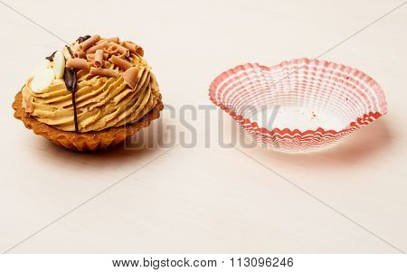 Sweet Food Cupcake And Paper Form On Table