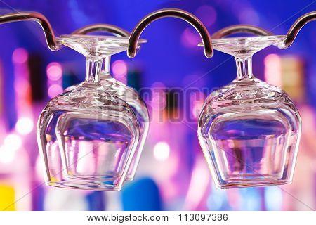 Cognac glasses on the bar hanger