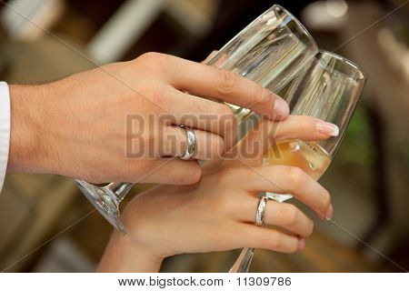 Bride And Groom Holding Glasses