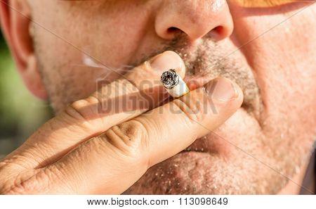 Close Up Of A Man Smoking Cigarette