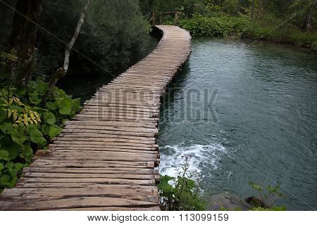Wooden Walkway Across River