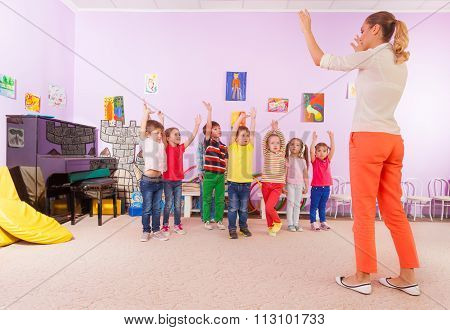 Kids boys and girls in kindergarten sport class