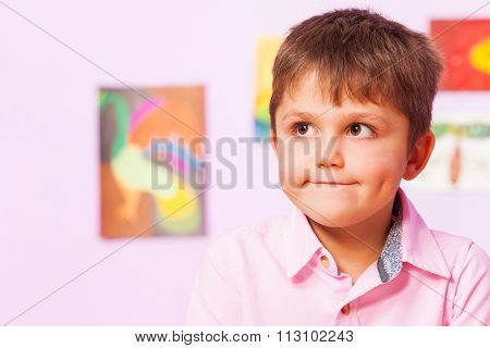 Boy with thinking troubled expression on face