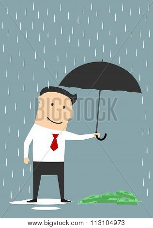 Businessman protecting money with umbrella