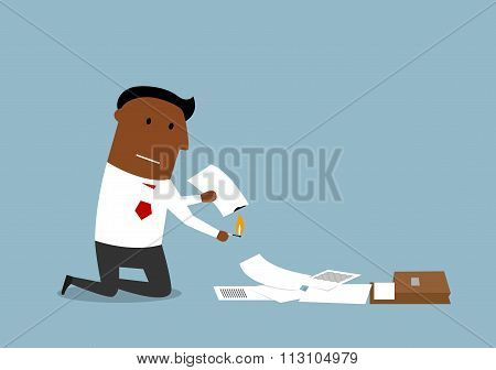 Businessman burning up paper and documents