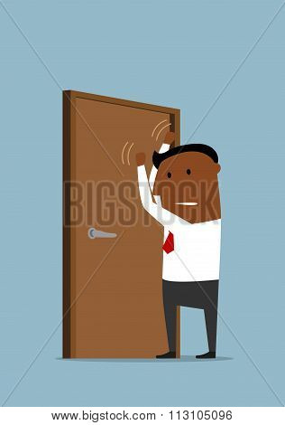 Businessman knocking at the closed door