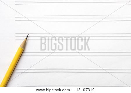 Music Sheet And Yellow Pencil