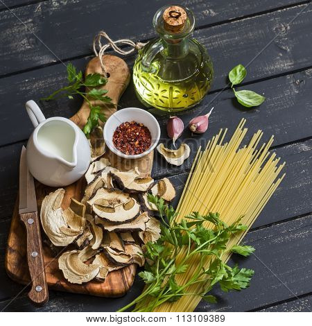 Raw Ingredients For Cooking Pasta With Porcini - Dried Porcini Mushrooms, Spaghetti, Cream, Garlic,