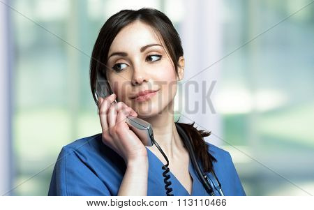Portrait of a female nurse talking on the phone