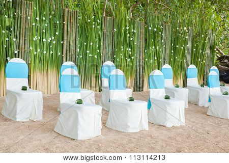 Floral Arrangements Located On Seats At A Wedding Ceremony
