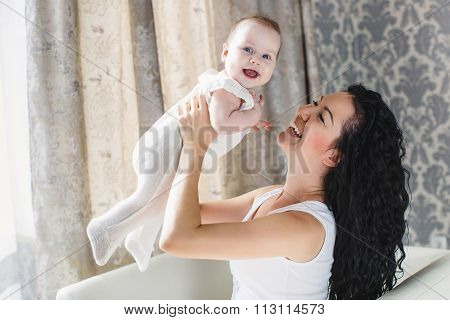 Portrait of happy mother and child in the home environment