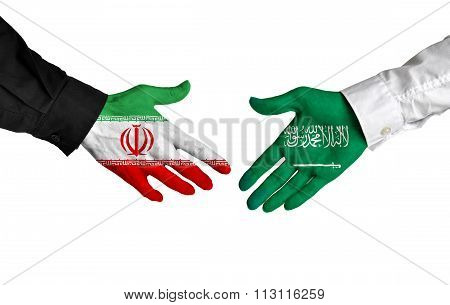 Iran and Saudi Arabia leaders shaking hands on a deal agreement