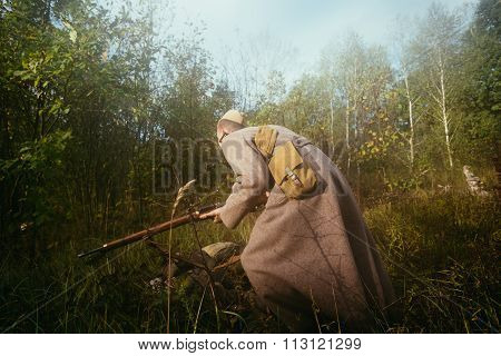 Unidentified re-enactor dressed as Soviet russian soldier runnin