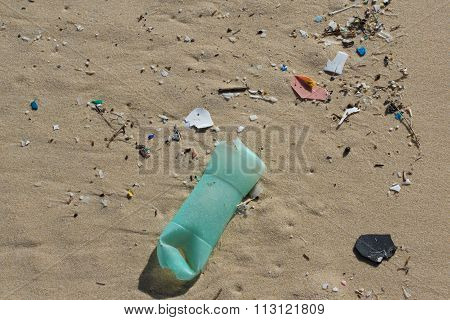 Various Garbage On The Beach At Summertime