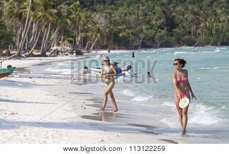 Young woman walking on the beautiful beach