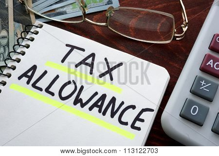 Notebook with tax allowances  sign on a table.